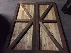 """Sliding Barn Doors built by Southpaw Trading Company . For this custom set of barn doors, we used cedar for the whole job. These are two 32"""" doors that be hung on a rail. Material Used: 2x4 (stained cedar) for the edges and crosses 2x6 (stained cedar) for the top and base 1x4 (cedar) for panels cuts on each type of wood is going to vary based on the opening of the door. Southpaw Trading Company is based in Dallas. We are available for custom jobs. contact us southpawtradingco@gmail.com"""