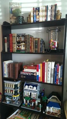 My lego display shelf...weaving it into my existing decor. I'm in love with how it looks! Each #lego building is a work of art. To me anyway. :) Lego Display Shelf, Legos, Bookcase, Lego Stuff, Lego Building, Lego Ideas, Interior Design, Storage, Artwork