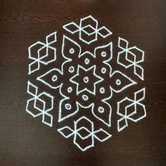 50 Most Beautiful White Rangoli Designs (ideas) that you can make during any occasion on the living room or courtyard floors. Easy Rangoli Designs Videos, Rangoli Designs Simple Diwali, Simple Rangoli Border Designs, Rangoli Simple, Rangoli Designs Latest, Rangoli Designs Flower, Rangoli Borders, Small Rangoli Design, Rangoli Patterns