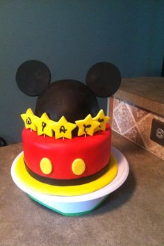 Mickey Mouse Ears Birthday Cake - Mickey Mouse cake - walt font lettering on stars and ears are 100% fondant.   Note to future makers of similar design - make the ears at least 3 days in advance so they have ample time to dry.  Ears were then stuck into the dome with skewers - toothpicks were too small.