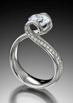Graceful platinum curves, scintillating with pavé, cradle your diamond.