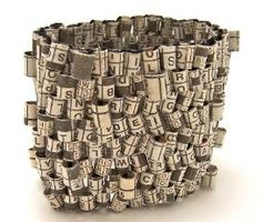 Newspaper crossword puzzle bracelets by Holly Anne Mitchell