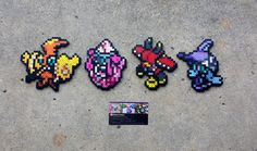 Handmade Perler bead sprites featuring the four legendary Tapus from Pokemon~! They can either be sold together or separately. These make the perfect gift for that nerdy someone and work great as wall decorations, cubicle knick-knacks, or fridge magnets. ITEM DETAILS: - Made with care in a smoke-free home - Ironed on both sides for durability - Pressed to make flat - All measure approximately (height x width): Tapu Koko - (5 x 5.5) Tapu Lele - (5 x 4) Tapu Bulu - (5 x 4.5) Tapu Fini - (5 ...