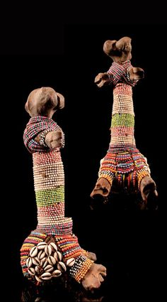 Africa | Doll from the Fali people of Cameroon | Bone, glass beads, cowrie shells and natural fiber.