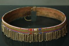 Africa   Beaded woman's belt  - Massai. Made from small beads,small pieces of metal chains and a zip strung onto a leather strip.   ca. 1960′s.
