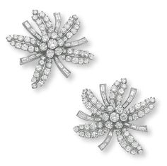 A PAIR OF DIAMOND EAR CLIPS, BY JOHN RUBEL   Each designed as a stylized flower, centering upon a circular-cut diamond cluster pistil, extending circular and baguette-cut diamond petals and leaves, mounted in platinum, circa 1946  By John Rubel
