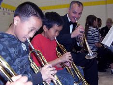 Music in the Schools Chris-and-trumpet-kids