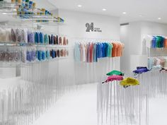 """Tokyo- and Milan- based Nendo has a store design based on an innovative product display system: variable-height vertical steel rods. Supported by """"points,"""" rather than by surfaces or lines, their bags seem to waft in the air like flowers in a light breeze, creating the illusion of a field of flowers in the store."""