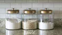 Love these glass canisters with gold lids!  (Blogger spray painted the lids.)