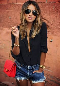 Easy breezy casual look with a hint of sexy in an unbutton black shirt and bold red Chanel bag. | Via Sincerely Jules