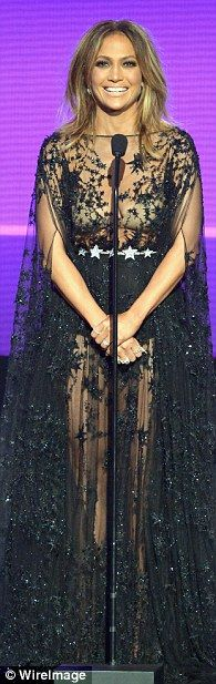 Star power: The singer next wore a flowing, sheer black gown in a star pattern...