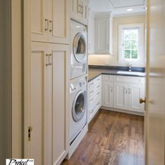 Could have a tall cabinet, like this one, that is right beside the washer, or even beside the refrig for brooms, ironing board, etc