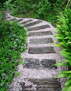 garden paths A garden pathway doesnt have to be ornate or expensive to be beautiful. Plant wood or flat stones into the ground and then pour gravel around, and voila! youve got a simple, cahrming garden path. Path Design, Landscape Design, Garden Design, Design Ideas, Design Jardin, House Landscape, Beautiful Home Gardens, Amazing Gardens, Path Ideas