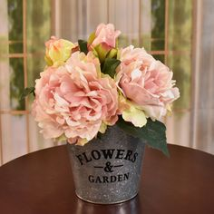 Our faux silk pink peonies look so realistic its hard to tell they are not real. Placed in a  metal garden planter. Set this design just about anywhere in your home or office.  Great  idea for gifts.  Perfect size for RVs, , side tables and baths. 11'' H x 9'' W x 9'' D