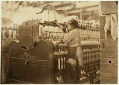 Little spinner in Bibb Mill No. 1, Macon, Ga. She was so small she had to climb up on to the spinning frame to mend broken threads. See also photo 488. Jan. 19, 1909.  Location: Macon, Georgia.