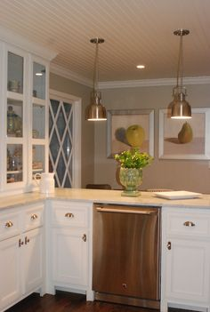 Kitchen,.. love the cream countertops against the white cabinets and beige walls