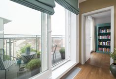 Big open window with a view on a balcony. Turquoise rollerblind and library. Big Windows, Open Window, Balcony, Turquoise, Interior Design, Courtyards, Nest Design, Large Windows, Home Interior Design