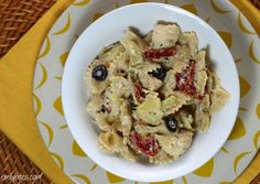 Mediterranean Pasta in a Creamy Feta Sauce with chicken, artichokes, olives, hummus and sun-dried tomatoes. Just 348 calories or 10 Weight Watchers SmartPoints per serving! www.emilybites.com