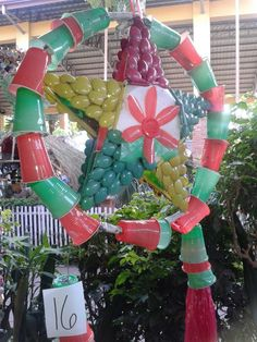 Recycling project by grade school kids: Christmas lantern made of used plastic glasses and spoons