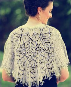 Hand knitted semicircular ivory lace shawl. 100% wool.