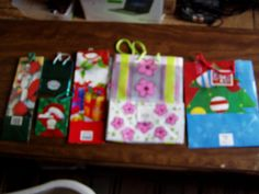 12 Assorted Gift Bags - Holidays, Christmas, Sesame Street, Aber Crombie Kids and More - for sale at Wenzel Thrifty Nickel ecrater store
