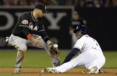 Game #27 5/4/2012: San Diego Padres' Orlando Hudson, right, looks back to watch Miami Marlins second baseman Omar Infante, left, drop the ball as Hudson steals second in the third inning during their baseball game, Friday, May 4, 2012, in San Diego. (AP Photo/Gregory Bull)