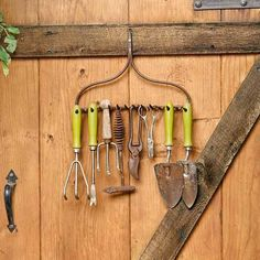 Got a rusty old steel rake that's seen better days? Don't just toss it. When mounted tines-out on a shed wall or a door, the rake's head becomes a vintage-look rack for your gardening tools.