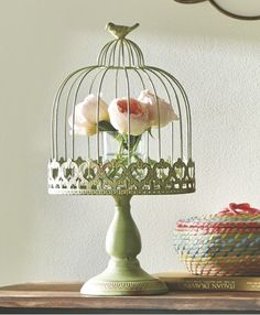 Top that entryway table with one or two unique accents like a birdcage-style wire cloche or a set of spring-inspired collectibles. It's the perfect place to bring a touch of the season to your entryway.
