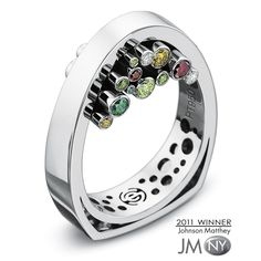 This unique setting of colored diamonds was inspired by and named in honor ofHans Hollein, the contemporary architect of the famous Juwelier Schullin store inVienna, Austria. In the Hollein ring,...