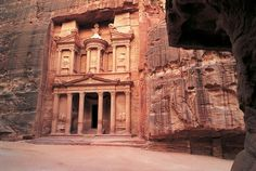 Petra, Jordan....half carved into rock and surrounded by mountains.