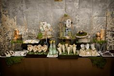 Rustic Romance - look closely at the wood mini tree trunks to hold food platters.  Might be hard to see.