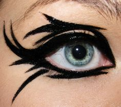 Fun with Eyeliner (otherwise known as super hero make-up)