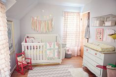 Love this for a baby girl nursery.  Great ideas to incorporate vintage prints with modern touches.