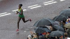 Ethiopia's Tiki Gelana leads to win the Women's Marathon in the rain, on Day 9 of the London 2012 Olympic Games, at Buckingham Palace.
