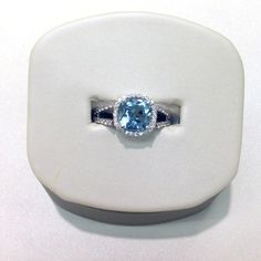 Aquamarine ring lined in diamonds #ring #jewelry #aquamarine #blue