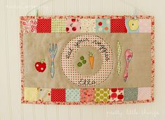 pretty patchwork placemat for Ella by nanaCompany, via Flickr