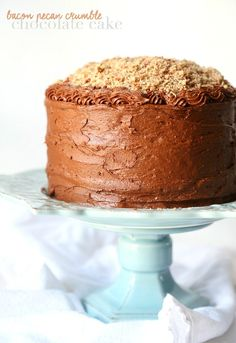 This Bacon Pecan Crumble Chocolate Cake is EPIC! It's a SUPER soft chocolate cake, delicious chocolate frosting and it's topped with a thick layer of caramel and salty bacon pecan crumble!! CRAZY GOOD!!