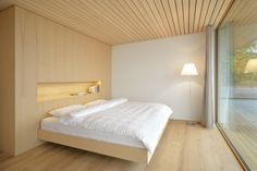 beautiful wooden detailing for master bedroom - Layered Wood Boxes: Weinfelden House by k_m architektur