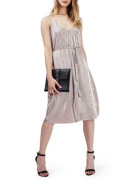 Satiny pleated fabric in shimmering silver glams up this midi-length slipdress from Topshop.