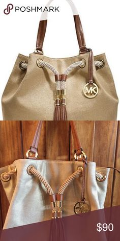 Michael Kors Marina gold tote This bag is in great condition. Perfect easy-going summer style canvas carryall. Trimmed in Rich leather with swishy tassel detailing, the rope drawstring adds nautical charm. magnetic closure, gold toned hardware, tassel detailing, logo medallion charm. Michael Kors Bags Totes