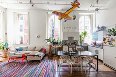 A Playful Tribeca Loft That Does A Teepee RIGHT #refinery29  http://www.refinery29.com/pj-mattan-bezar-home-tour#slide-13  The real remote-controlled airplane used to hang as a prop in the entrance of the former Jack Spade store on Greene Street in SoHo. When the store interior changed, a friend gifted it to Mattan.The dining room table and sofa are from Blue Dot, the orange-red coffee table is by Tom Dixon, and the dining room chairs are MOROSO by Ross Lovegrove.