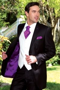 Purple lining in this wedding jacket with matching accessories. #groomstyle