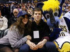 jesse Eisenberg and girlfriend Anna Strout is seen during the game between the Detroit Pistons and Indiana Pacers on January 2, 2016 at Bankers Life Fieldhouse in Indianapolis, Indiana.