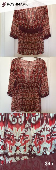 CAbi Silk Tribal Print Bohemian Blouse CAbi 100% Silk Tribal Print Bohemian Blouse. Size Small. This blouse has a very deep V neck a cami has to be worn with it. It is a hard to find CAbi classic.  Super light weight and sheer. Super Cute! CAbi Tops Blouses