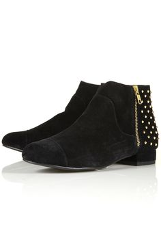 Stud back black boots by Topshop.