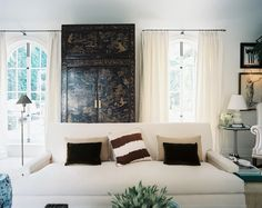 Mark D. Sikes & Michael Griffin Photo - A white couch and a chinoiserie cabinet in a neutral living space