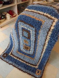 Old woollen blankets rag rug. Hearth rug sized.