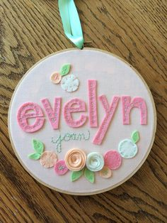 This Hand-Embroidered Hoop Art uses customized names and flowers to add a modern vintage accent to your child's bedroom. The words are