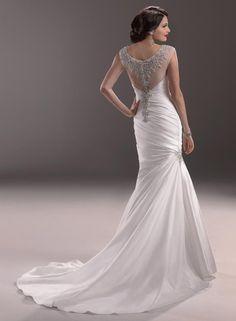 Делюсь красотой, найденной на просторах сети. Я искала платья, которые гармонировали бы с моими собственными свадебными аксессуарами в серебристо-жемчужной гамме, и вот - нашла такую интересную коллекцию - очень тонкие вышивки, украшенные стразами, серебристым бисером и стеклярусом, жемчужными бусами - все очень нежное, кропотливой работы. Только не спрашивайте, кто модельер. Сама не знаю.