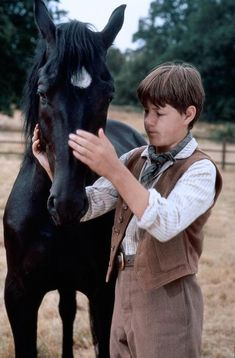 Docs Keepin Time was a black American Quarter Horse who played the part of Black Beauty in the 1994 film adaptation of Anna Sewell's novel of the same name. This seasoned performer (a former race horse) also played The Black in the American television series Adventures of the Black Stallion, and Gulliver in the film The Horse Whisperer. He died in 2013, aged 26.